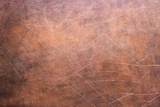 Textura de cobre ou bronze, superfície de metal rústica
