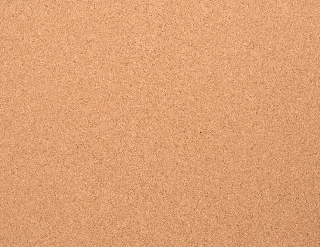 Textura de cortiça marrom. quadro para anexar papel a um botão, full frame