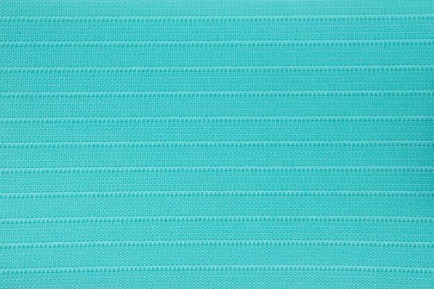 Textura de cortina cega em tecido turquesa