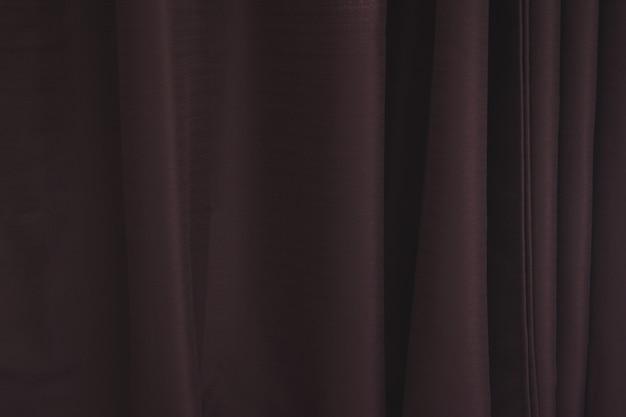 Textura de cortina marrom com linhas verticais.