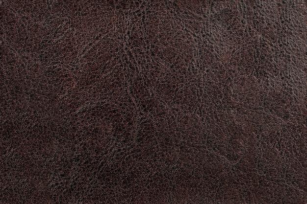 Textura de couro natural marrom escuro bonito.