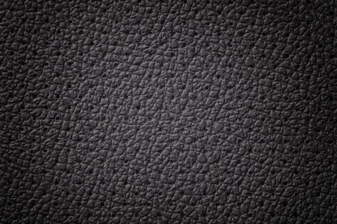 Textura de couro preto perfurado com moldura gradiente