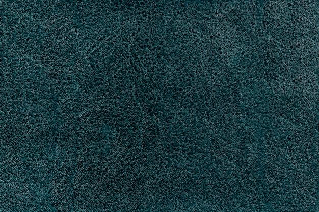 Textura de couro velho em verde escuro.