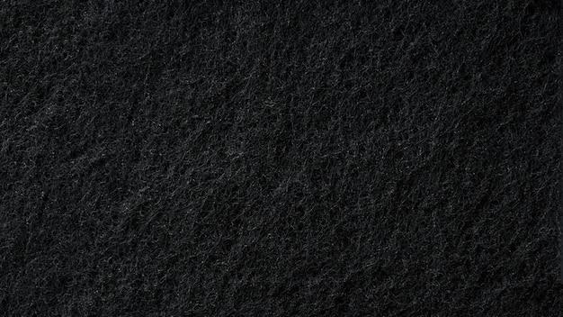 Textura de esponja preta como fundo abstrato preto