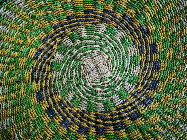 Textura de esteira de vime colorida feita de fundo de junça seca