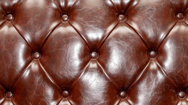 Textura de estofamento de couro do sofá. sofá de luxo marrom