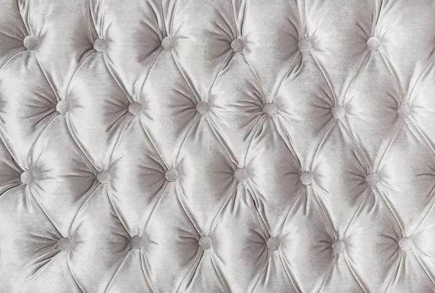 Textura de estofamento de tecido tufado com capitone branco