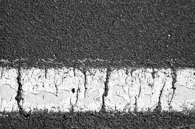 Textura de estrada de estrada de asfalto com marcações.