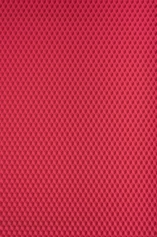Textura de favo de mel. geométrico vermelho.