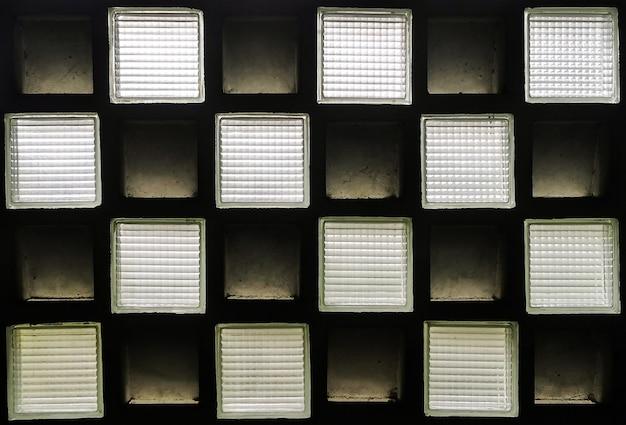 Textura de forma quadrada de vidro fosco e parede de tijolo. fundo abstrato