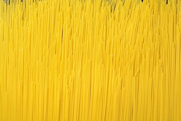 Textura de fundo abstrato do close up da massa. espaguete cru.