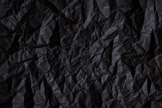 Textura de fundo abstrato preto por papel escuro amassado