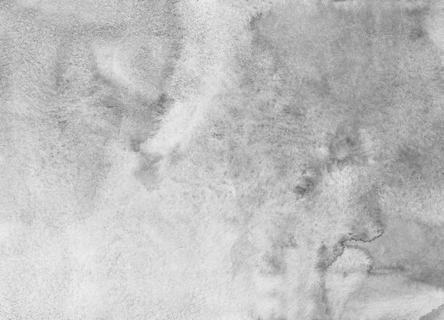 Textura de fundo cinza claro em aquarela. manchas brancas e pretas no papel.