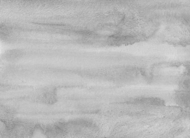 Textura de fundo cinza claro em aquarela. pano de fundo abstrato cinza. manchas monocromáticas no papel.