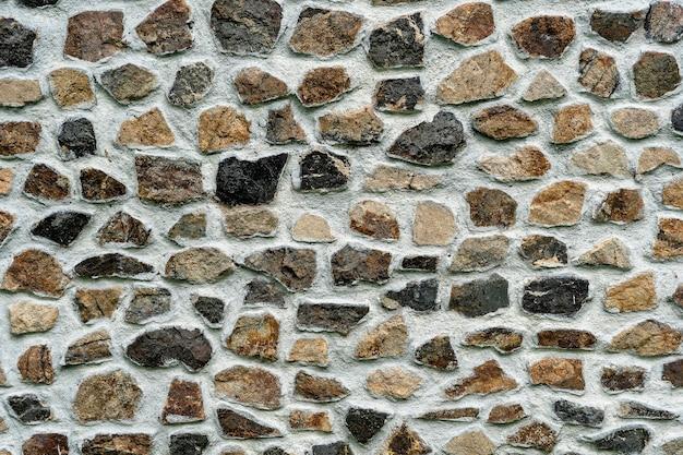 Textura de fundo da parede de pedra, close-up. fachada de pedra natural, textura de azulejos de parede