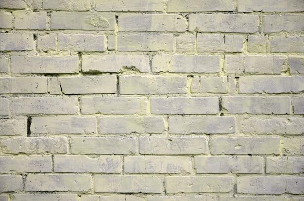 Textura de fundo da velha parede de tijolos, pintado em amarelo