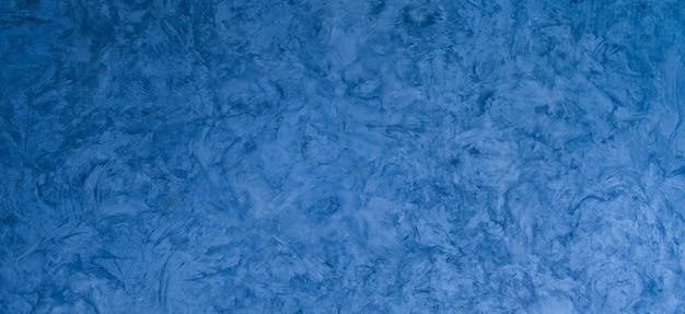 Textura de fundo de argamassa azul, parede azul, fundo de parede de crack, textura de concreto