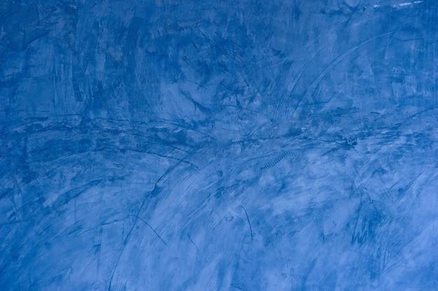 Textura de fundo de argamassa azul rachadura fundo da parede, textura de concreto