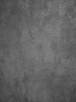 Textura de fundo de concreto cinza escuro irregular ou superfície de parede de gesso