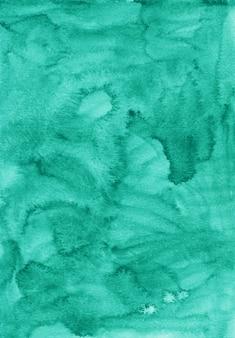 Textura de fundo de cor verde marinho líquido em aquarela. cenário de esmeralda aquarelle. manchas no papel.
