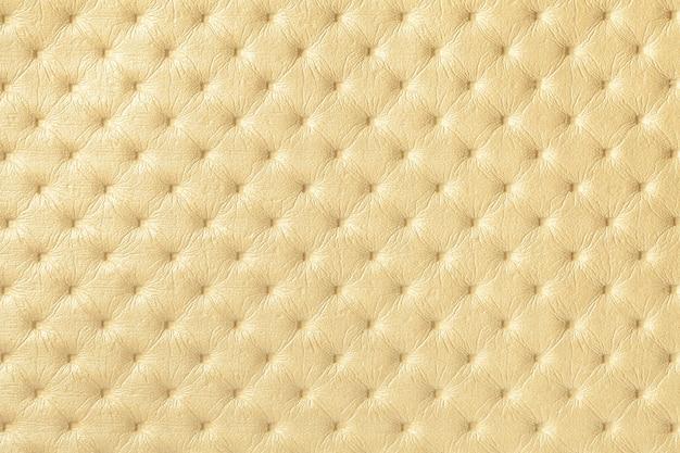 Textura de fundo de couro amarelo claro com padrão capitone