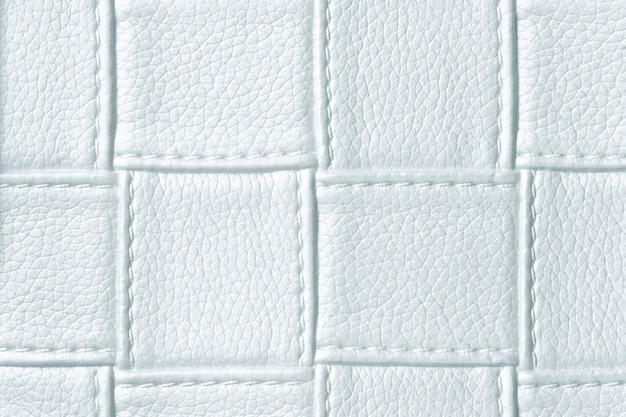 Textura de fundo de couro azul claro com padrão quadrado e ponto
