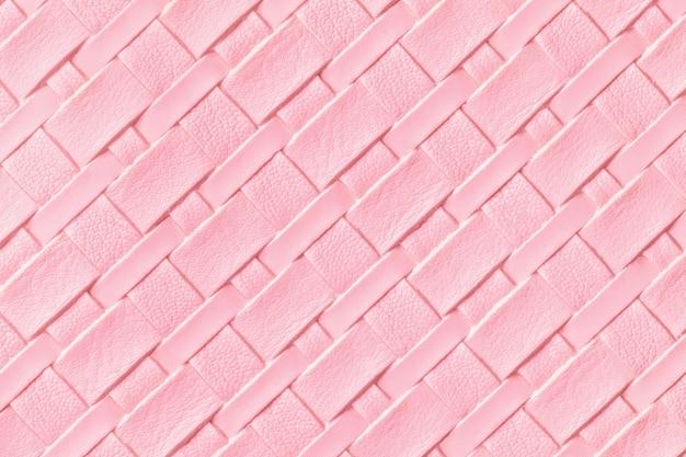 Textura de fundo de couro rosa claro com padrão de vime