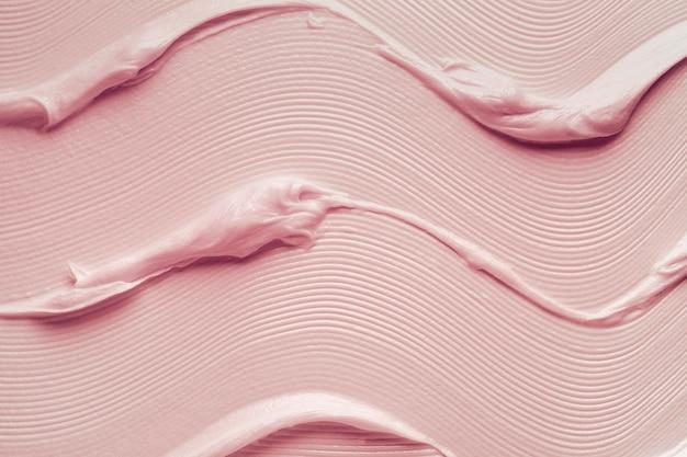 Textura de fundo de espuma de sabão líquido rosa mancha cosmética