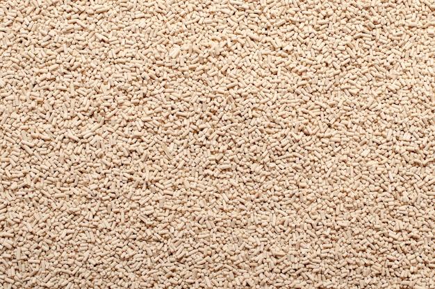 Textura de fundo de levedura granular seca vista superior pilha de textura de grânulos de levedura seca