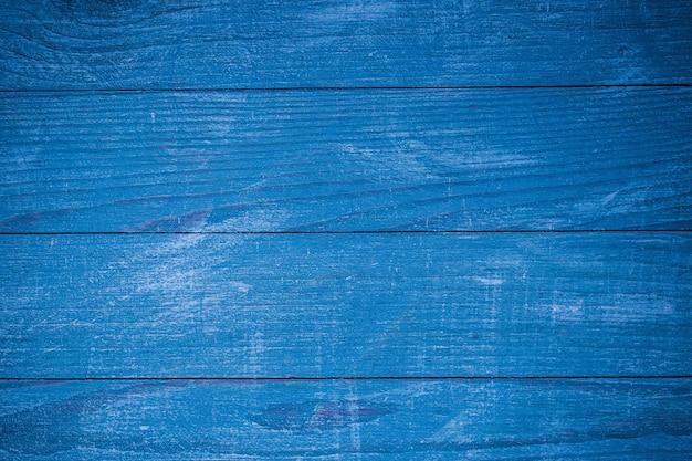 Textura de fundo de madeira azul vintage com nós e orifícios de pregos. parede de madeira pintada velha.