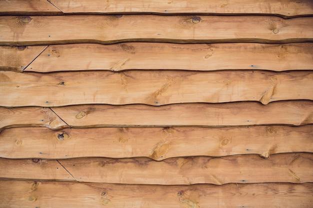 Textura de fundo de madeira natural. feche acima do tronco de árvore de seção transversal. fundo de textura de tronco de árvore velha