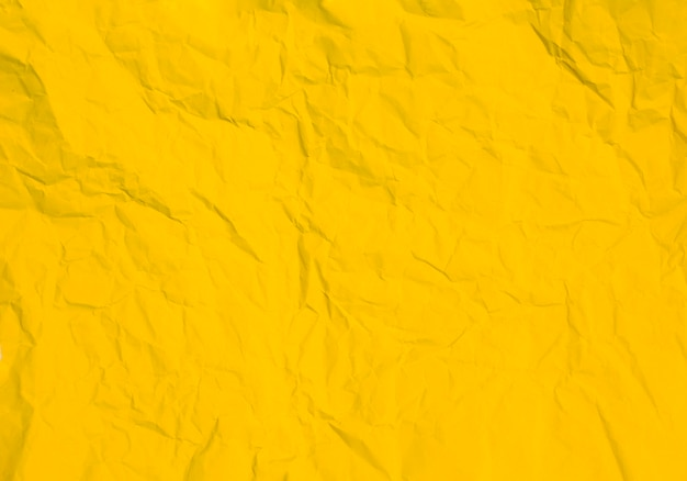 Textura de fundo de papel amarelo amassado