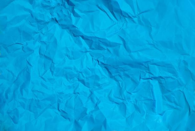 Textura de fundo de papel azul amassado