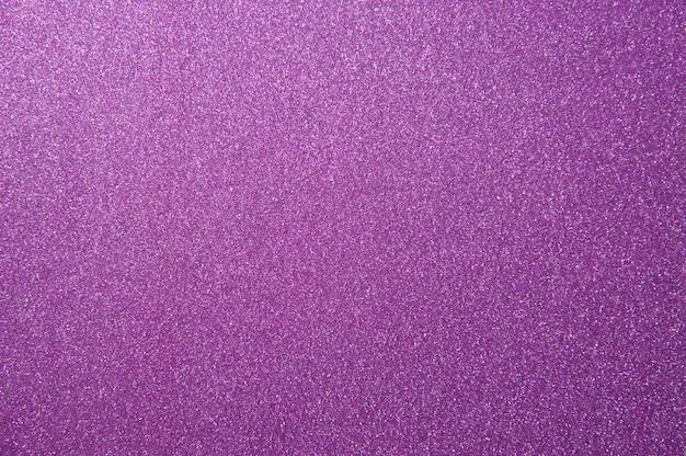 Textura de fundo de papel glitter roxo para design de cartões de natal ou ano novo