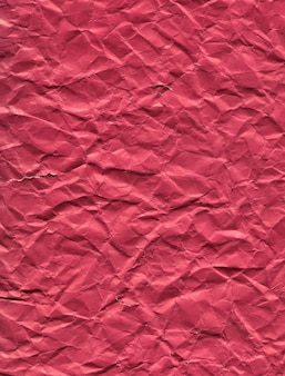 Textura de fundo de papel rosa escuro amassado