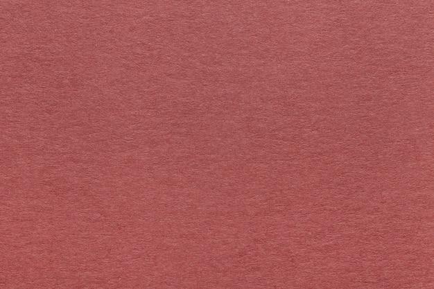 Textura de fundo de papel vermelho escuro velho