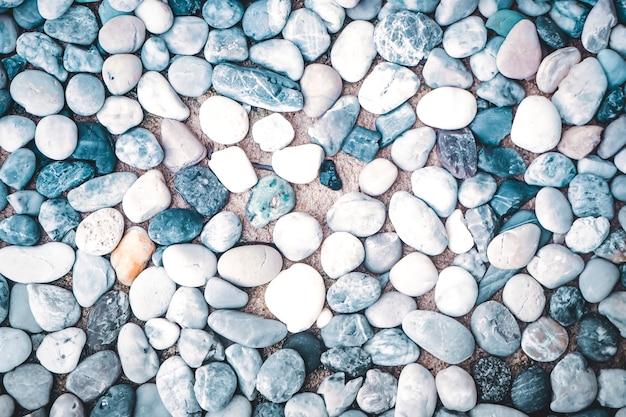 Textura de fundo de pequenas pedras de cor seixos