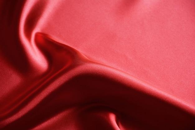 Textura de fundo de seda ondulada de luxo vermelho