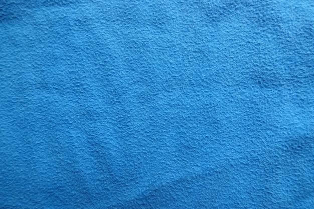 Textura de fundo de tecido azul de close-up