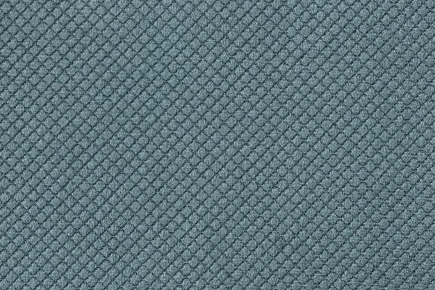Textura de fundo de tecido fofo azul claro com padrão romboide, macro.