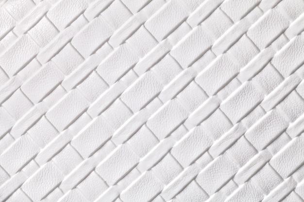 Textura de fundo de têxteis de couro branco com padrão de vime, macro.