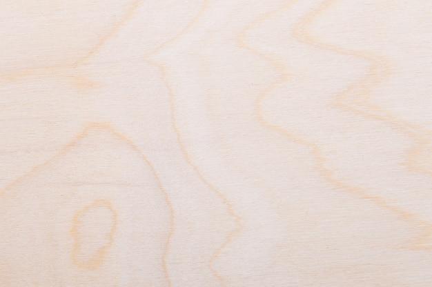 Textura de fundo de uma madeira clara recém-cortada com linhas curvas