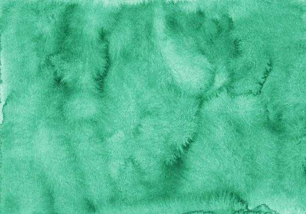 Textura de fundo esmeralda em aquarela. pano de fundo azul verde líquido abstrato aquarelle. pintado à mão