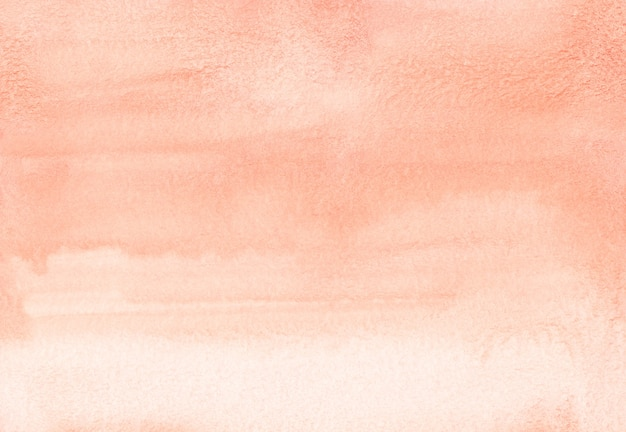 Textura de fundo gradiente coral claro em aquarela. traçados de pincel no papel. cenário de cor pêssego. pintado à mão