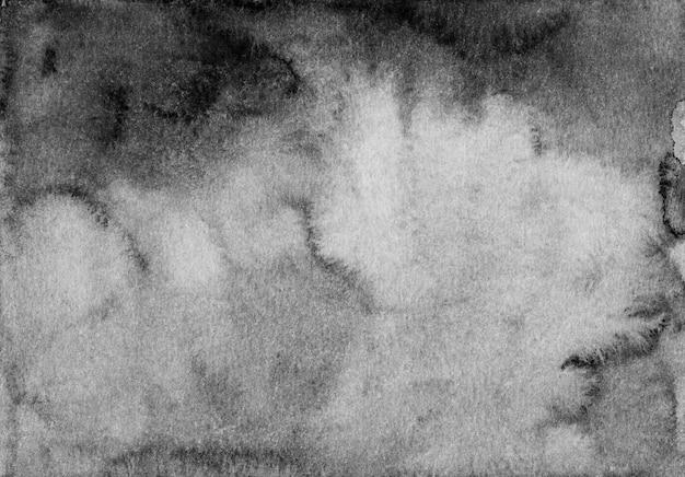 Textura de fundo gradiente em aquarela preto e branco. aquarelle abstrato antigo cenário monocromático. traçados de pincel no papel.