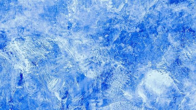Textura de fundo grunge pintada de azul. fundo de parede azul decorativo abstrato bonito. banner de textura com espaço para texto.