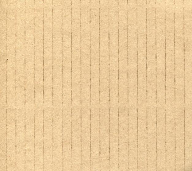Textura de fundo listrado de papelão amarelo