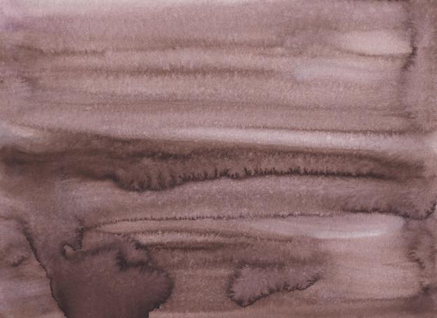 Textura de fundo marrom escuro em aquarela. taupe velho pintado à mão. manchas no papel.