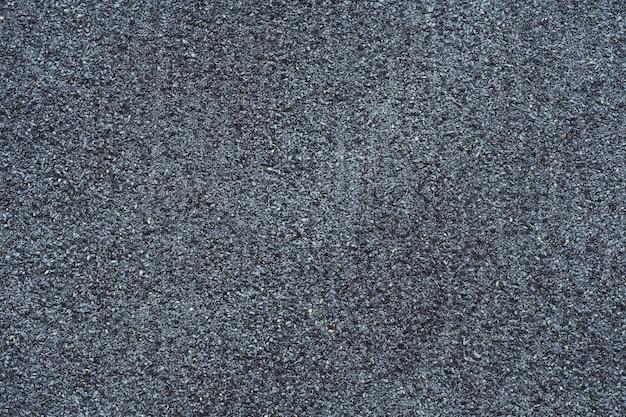 Textura de fundo. superfície cinzenta feita de pequenas pedras, feltro para telhados. copie o espaço