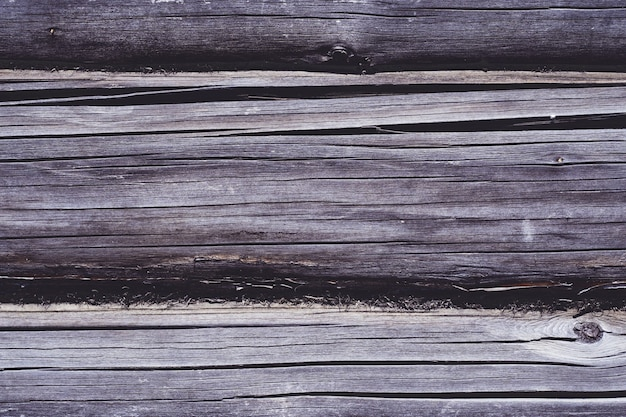 Textura de fundo. superfície marrom envelhecida da casa de toras, copie o espaço